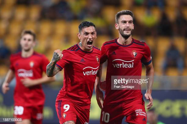 Roberto Torres of CA Osasuna celebrates after scoring their sides second goal from the penalty spot with team mate Ezequiel Ávila during the La Liga...