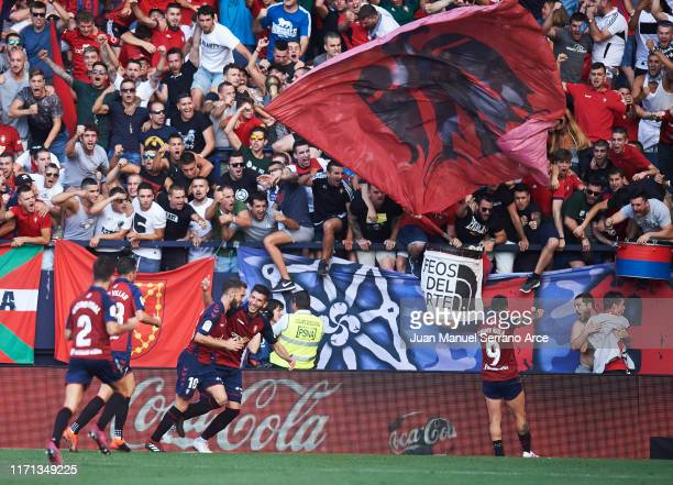 Roberto Torres of CA Osasuna celebrates with teammates after scoring his team's second goal during the Liga match between CA Osasuna and FC Barcelona...