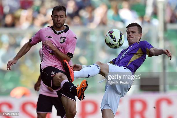 Roberto Vitiello of Palermo and Josip Ilicic of Fiorentina compete for the ball during the Serie A match between US Citta di Palermo and ACF...