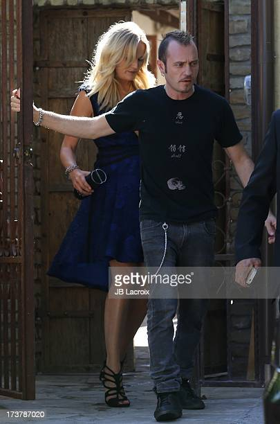 Roberto Zincone and Malin Akerman are seen on July 17, 2013 in Los Angeles, California.