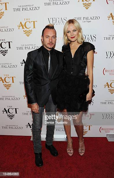 Roberto Zincone and Malin Akerman arrive at the grand opening of Simon Hammerstein's The ACT Las Vegas at The Palazzo on October 27 2012 in Las Vegas...
