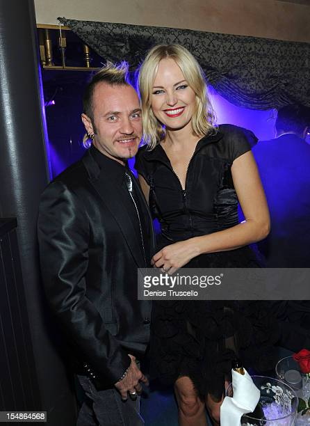 Roberto Zincone and Malin Akerman attend the grand opening of Simon Hammerstein's The ACT Las Vegas at The Palazzo on October 27 2012 in Las Vegas...