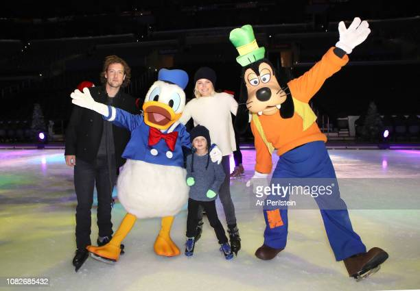 Roberto Zincone Donald Duck Sebastian Zincone Malin Akerman and Goofy attend Disney On Ice Presents Dare to Dream Celebrity Skating Party at Staples...