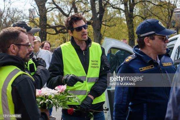 Roberts Klimovics former tv host and one of the People's Power Front leaders is detained by the police next to the Freedom Monument in Riga Latvia on...