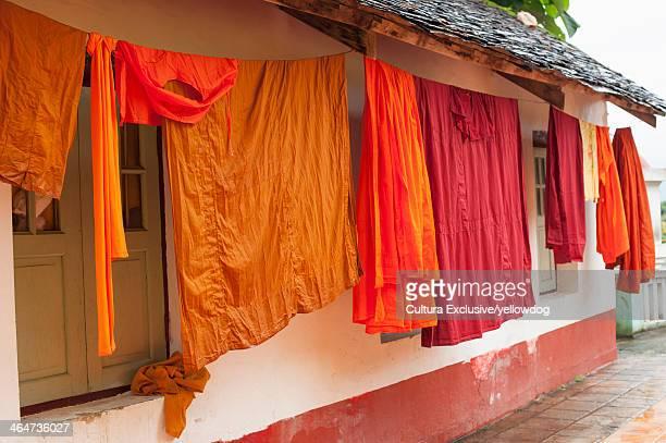 Robes hanging outside Buddhist monastery, Kentung, Shan State, Myanmar
