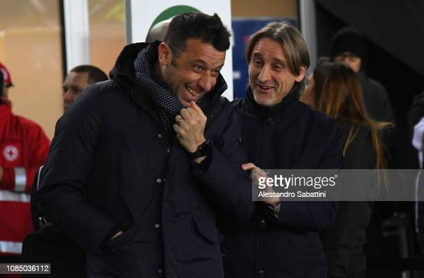 Robeto D'Aversa of Parma Calcio embraces Davide Nicola head coach of Udinese Calcio during the Serie A match between Udinese and Parma Calcio at...