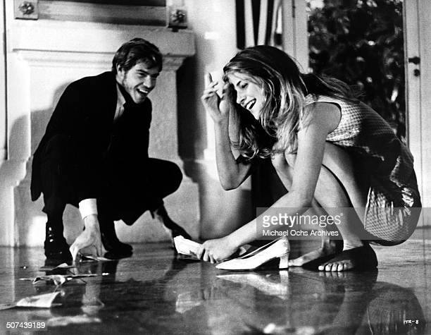 Robie Porter Charlotte Rampling gather the money she won at the casino in a scene from the movie 'Three' circa 1967