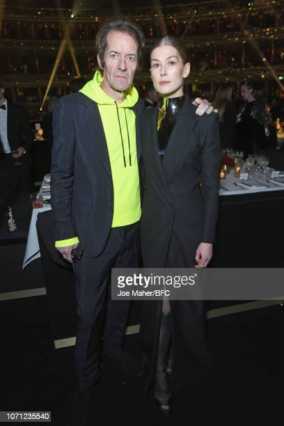 Robie Uniacke and Rosamund Pike attend The Fashion Awards 2018 In Partnership With Swarovski at Royal Albert Hall on December 10 2018 in London...