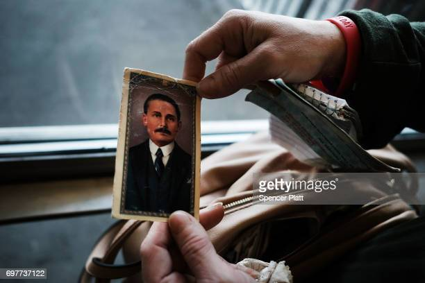 Robin a patient at a Brooklyn methadone clinic for those addicted to heroin displays a picture of the Venezuelan doctor and religious figure Dr Jose...