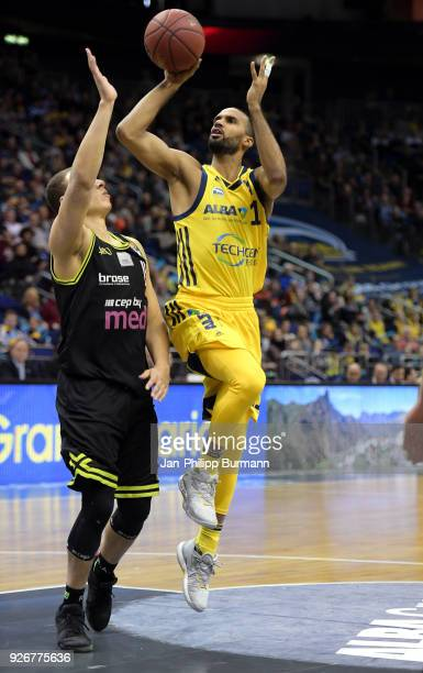 Robin Amaize of medi Bayreuth and Akeem Vargas of Alba Berlin during the easyCredit BBL game between Alba Berlin and medi Bayreuth at MercedesBenz...