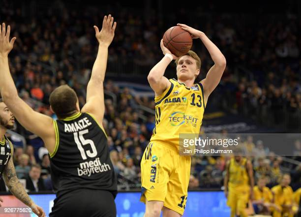 Robin Amaize of medi Bayreuth and Marius Grigonis of Alba Berlin during the easyCredit BBL game between Alba Berlin and medi Bayreuth at MercedesBenz...