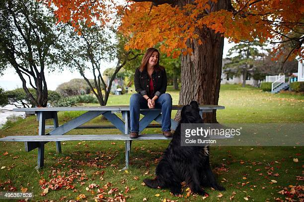 Robin Baranyai, a community journalist who responded to the Facebook call for action poses at her Wellington home with her dog Otis, on October 21,...