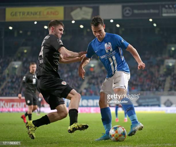 Robin Becker of Eintracht Braunschweig and Lukas Scherff of Hansa Rostock battle for the ball during the 3 Liga match between Hansa Rostock and...