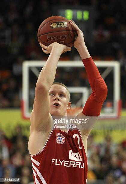 Robin Benzing of Bayern Muenchen throws the ball during the Basketball Bundesliga match between FC Bayern Muenchen and medi Bayreuth at AudiDome on...