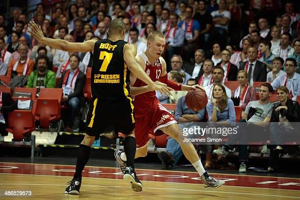 Robin Benzing of Muenchen fights for the ball with Shawn Huff of Ludwigsburg during the match between FC Bayern Muenchen and Telekom Baskets Bonn at...
