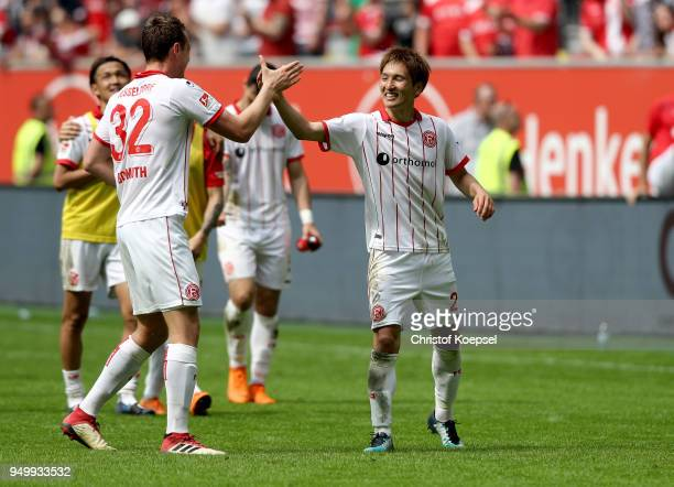 Robin Bormuth and Genki Haraguchi of Duesseldorf celebrate after the Second Bundesliga match between Fortuna Duesseldorf and FC Ingolstadt 04 at...
