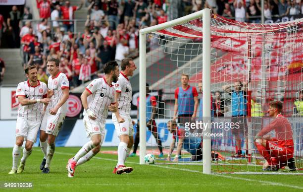 Robin Bormuth of Duesseldorf celebrates the third goal with his team mates during the Second Bundesliga match between Fortuna Duesseldorf and FC...