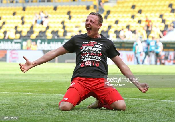 Robin Bormuth of Duesseldorf jubilates after moving up into the Bundesliga after the Second Bundesliga match between SG Dynamo Dresden and Fortuna...