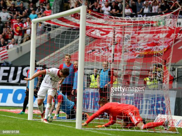 Robin Bormuth of Duesseldorf scores the third goal against Oerjan Nyland of Ingolstadt during the Second Bundesliga match between Fortuna Duesseldorf...
