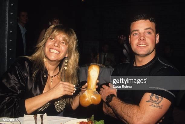 Robin Byrd and John Wayne Bobbitt share a table at The Tunnel 1994 New York