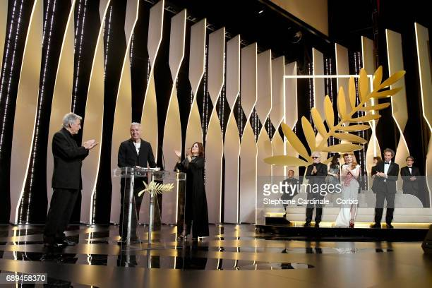 Robin Campillo is applauded by director CostaGavras and jury members Agnes Jaoui and Will Smith jury president Pedro Almodovar and jury members Fan...