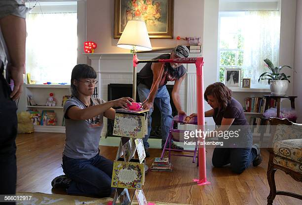 Robin Carpenter Craig Simmons and Rebecca Thompson all part of Brett Doar's team work to set up a part of a Rube Goldberg machine in a home in...
