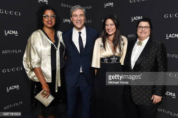 Robin Coste Lewis LACMA CEO and Wallis Annenberg Director Michael Govan wearing Gucci actor Katherine Ross wearing Gucci and photographer Catherine...