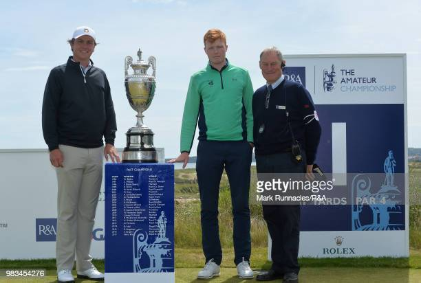 Robin Dawson of Tramore and Jovan Rebula of Republic of South Africa pose with match referee Neil McConachie and The Amateur Championship trophy...