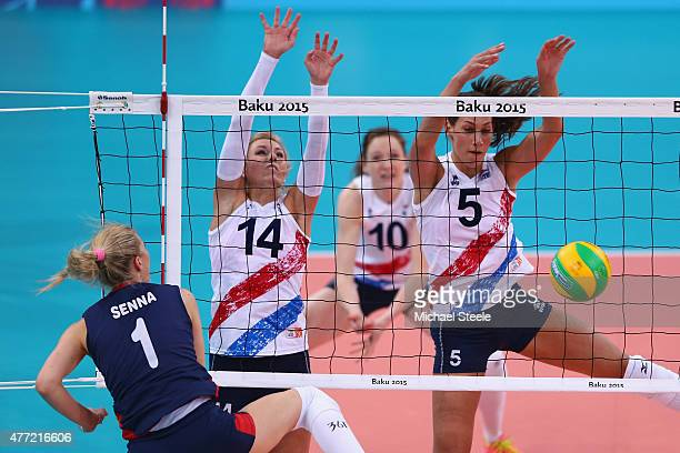 Robin de Kruijf and Laura Dijkema of Netherlands block a spike from Usic Senna of Croatia in the Women's Volleyball Preliminary Pool B match between...