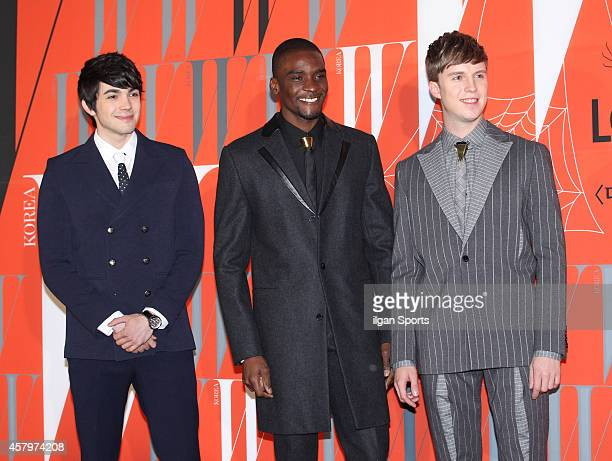 Robin Deiana Samuel Okyere and Julian Quintart pose for photographs during the W Korea campaign Love Your W party at Fradia on October 23 2014 in...