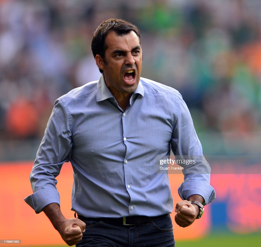 Robin Dutt, head coach of Bremen celebrates his first home win as head coach during the Bundesliga match between Werder Bremen and FC Augsburg at Weserstadion on August 17, 2013 in Bremen, Germany.