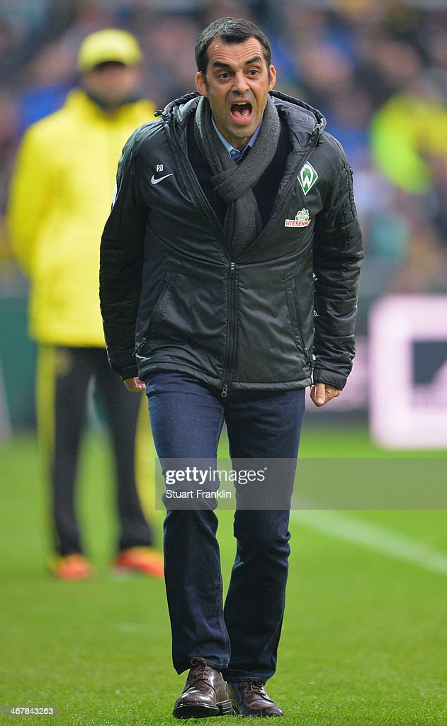 Robin Dutt, head coach of Bremen gestures during the Bundesliga match between Werder Bremen and Borussia Dortmund at Weserstadion on February 8, 2014 in Bremen, Germany.