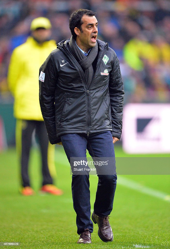 Robin Dutt, head coach of Bremen looks on during the Bundesliga match between Werder Bremen and Borussia Dortmund at Weserstadion on February 8, 2014 in Bremen, Germany.