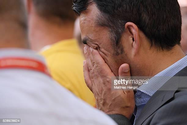 Robin Dutt sportding director of VfB Stuttgart cries while he speaks to the fans after the Bundesliga match between VfB Stuttgart and 1 FSV Mainz 05...