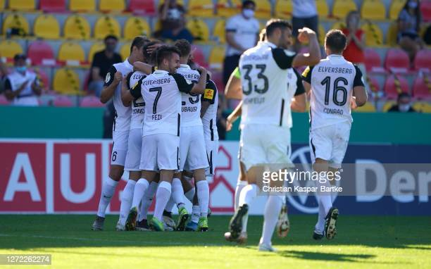Robin Fellhauer of SV Elversberg celebrates with his team mates after scoring his team's third goal during the DFB Cup first round match between SV...