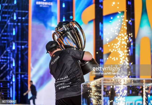 Robin flusha Ronnquist walks off the stage with the winners' cup after CounterStrike Global Offensive final game between FaZe Clan and Fnatic on...