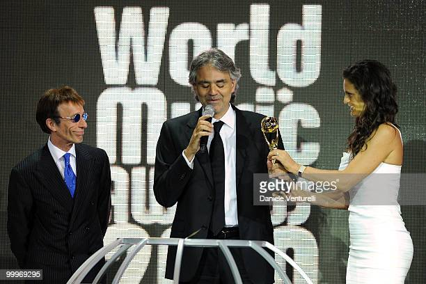 Robin Gibb Andrea Boccelli and Veronica Berti speak on stage during the World Music Awards 2010 at the Sporting Club on May 18 2010 in Monte Carlo...