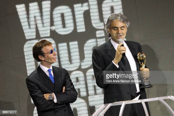 Robin Gibb of the Bee Gees and Andrea Boccelli speak on stage during the World Music Awards 2010 at the Sporting Club on May 18 2010 in Monte Carlo...