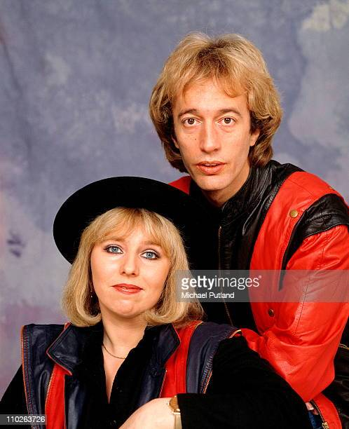 Robin Gibb of the Bee Gees with his wife Dwina studio portrait London 1984