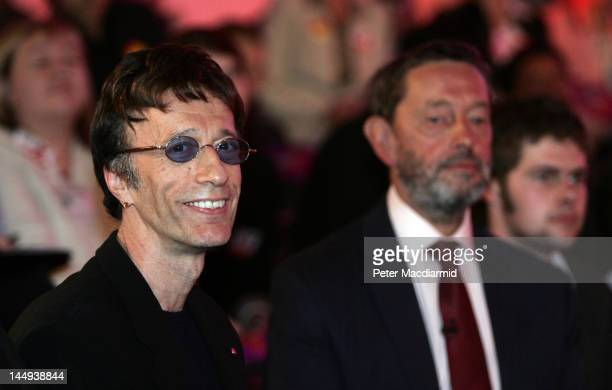 Robin Gibb stands next to David Blunkett at a Labour Party election rally on May 3 in Huddersfield England All party leaders are working hard on the...