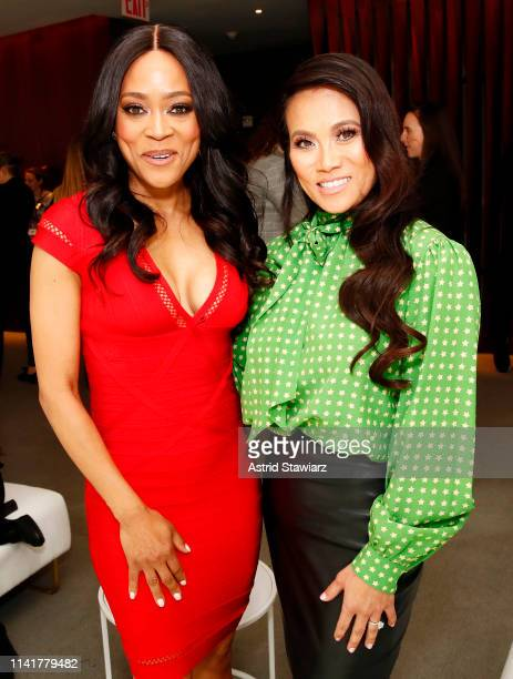Robin Givens and Dr Sandra Lee aka Dr Pimple Popper attend Discovery Inc 2019 NYC Upfront at Alice Tully Hall on April 10 2019 in New York City