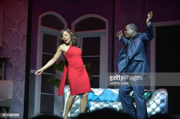 Robin Givens and Johnny Gill perform onstage during Priest Tyaire Productions Momma's Boy stage play day 1 at James L Knight Center on November 11...