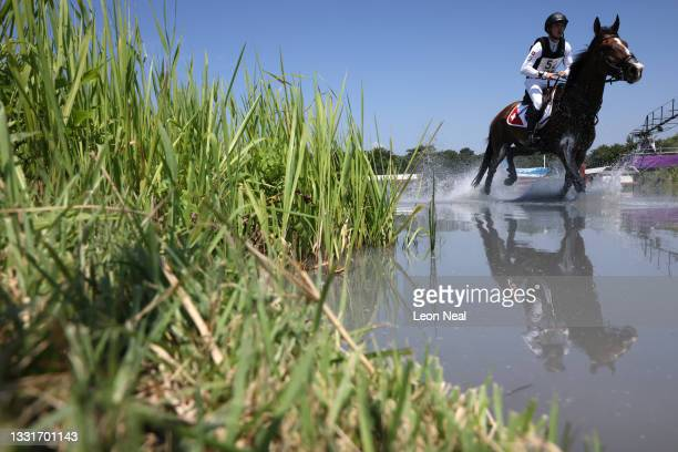 Robin Godel of Team Switzerland riding Jet Set competes during the Eventing Cross Country Team and Individual on day nine of the Tokyo 2020 Olympic...