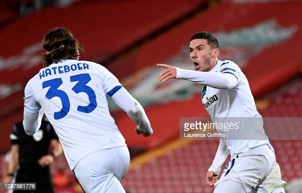 Robin Gosens of Atalanta B.C. Celebrates with Hans Hateboer after scoring their team's second goal during the UEFA Champions League Group D stage...