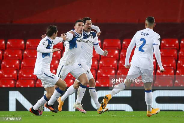 Robin Gosens of Atalanta B.C. Celebrates with his team mates after scoring their team's second goal during the UEFA Champions League Group D stage...
