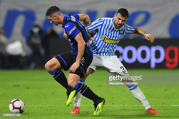 Robin Gosens of Atalanta BC competes for the ball with Andrea Petagna of Spal during the serie A match between SPAL and Atalanta BC at Stadio Paolo...