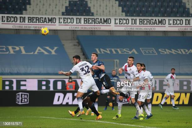 Robin Gosens of Atalanta BC scores their team's first goal under pressure from Pedro Pereira of F.C. Crotone during the Serie A match between...