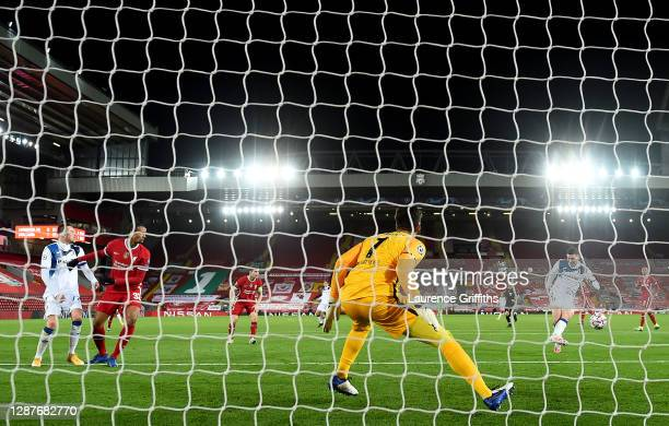 Robin Gosens of Atalanta B.C. Scores their team's second goal past Alisson Becker of Liverpool during the UEFA Champions League Group D stage match...