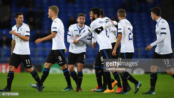 Robin Gosens of Atalanta celebrates with his team mates after scoring his sides third goal during the UEFA Europa League group E match between...