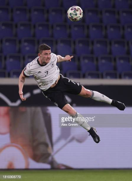 Robin Gosens of Germany jumps for a header during the FIFA World Cup 2022 Qatar qualifying match between Germany and North Macedonia at...